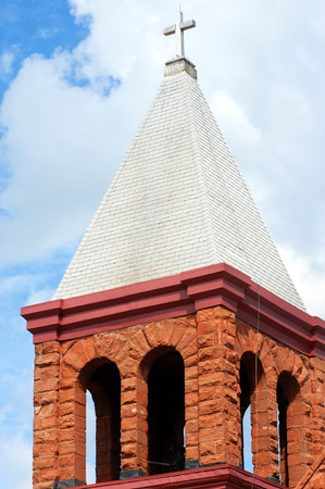 mined: Bell town on the Grace Christian Church is designed with locally mined red sandstone.  It is located in Houghton, Michigan and is over 100 years old.