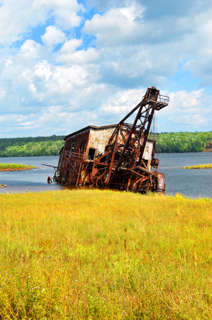reclamation: Sitting in the shallows of Torch Lake, a copper reclamation dredge sits rusting and abandoned.
