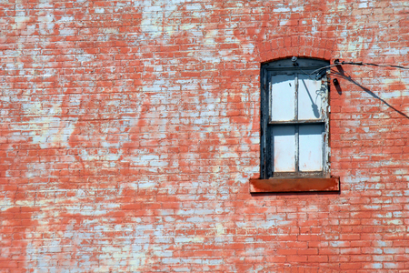 hancock: Native red sandstone frames closed window at the historic Quincy Copper Smelter in Hancock, Michigan. Stock Photo