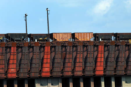 marquette: Conveyor has coal ore cars lined up for shipping.  Train cars form line for loading in Marquette, Michigan. Stock Photo