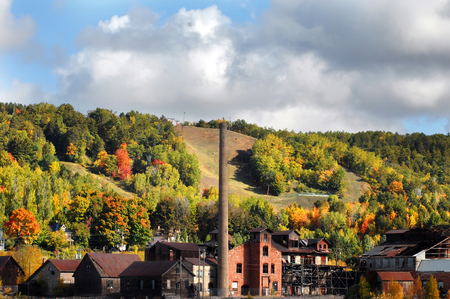 hancock building: Landscape image of Upper Peninsula, Michigan in the Fall.  Old Quincy Copper Smelter is in the foreground with Qincy Hill and Michigan Tech Ski Slope in the background. Stock Photo