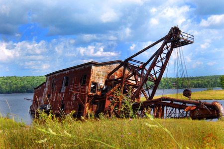 Landmark in Upper Peninsula, Michigan, lies rusting in Torch Lake.  the reclamation suction dredge lies near Mason, Michigan.
