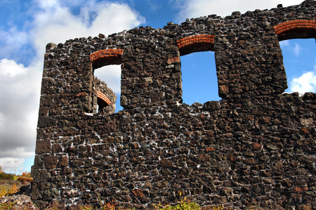 boiler house: Window on No. 4 boiler house ruins gives view of blue sky.  Ruins are part of the Quincy Copper Mine in the Keweenaw National Historical Park near Houghton, Michigan.