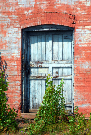 smelter: White weathered doorway sits surrounded by native red sandstone.  Building is part of old Quincy Copper Smelter. Stock Photo