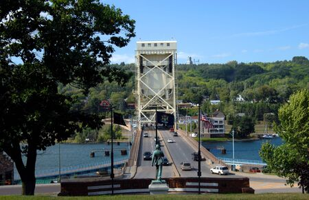 portage: Veterans memorial park in Houghton Michigan overlooks the Portage Lake Lift Bridge connecting the towns of Hancock and Houghton, Michigan.  Memorial Union Soldier guards the canal and waterway.