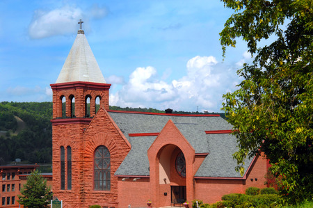 methodist: Grace United Methodist Church is a landmark in Houghton, Michigan.  Built of locally mined sandstone, the architecture is Richardsonian Romanesque.