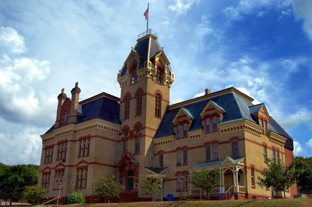 lintels: Victorian era county courthouse in Houghton, Michigan is designed with local red sandstone and Lake Superior copper for the roof.  Houghton County Courthouse is over 120 years old.