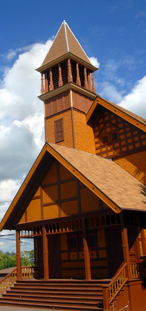 congregational: Historic, First Congregational Church of Lake Linden, Michigan, is composed of Victorian Stick Architecture.  Painted yellow and trimmed in brown, this church has a tower and belfry.