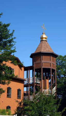 byzantine: Byzantine Rite Catholic Monastery sits near Eagle River, Michigan, in Upper Peninsula.  Its architecture includes a free-standing, domed, stairwell.  Monastery is surrounded by trees and nature.