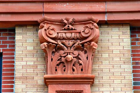 douglas: Beautiful capstone designed out of red sandstone is part of the Douglas House, an historic building in downtown Houghton, Michigan.
