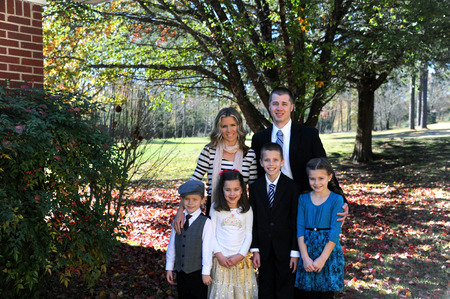 Family Of Six Poses Outside Their Home They Are Dressed Up Stock Photo Picture And Royalty Free Image 49447412