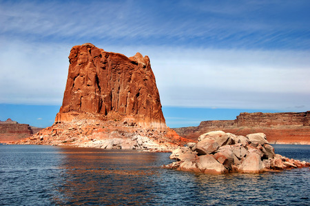 mesas: Big and small rocks line the shore of Lake Powell.  Mesas and monoliths dot the landscape. Stock Photo