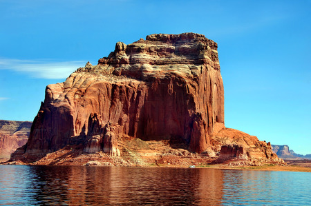 houseboat: Beautiful sandstone rocks and cliffs tower over houseboat on the Colorado River and Lake Powell. Stock Photo