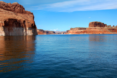 traverse: Canyon walls go on and on as you traverse Lake Powell.  Red sandstone cliffs line each side.