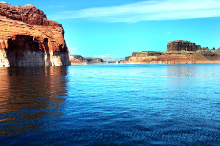 meanders: Red sandstone walls seem to go on forever as the Colorado River meanders around the waterways of Lake Powell in Arizona.