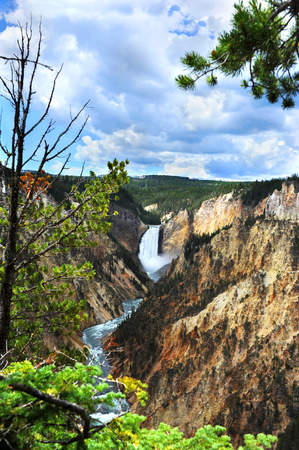 lower yellowstone falls: Landscape image of Lower Falls in Yellowstone National Park.  River snakes around canyon walls and clouds hang low over canyon walls. Stock Photo