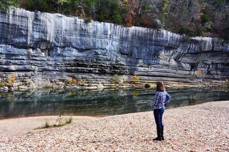 rugged: Woman stands and admires the rugged cliffs of the Buffalo National River in Northern Arkansas.