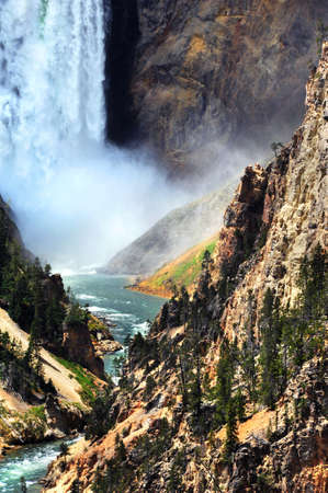 lower yellowstone falls: Bottom of Lower Falls in Yellowstone National Park has thunderous spray and crashing water.  Yellowstone River curves and twists its way through the steep and high canyon walls.