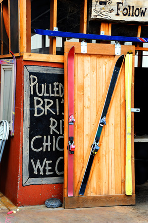 emigrant: Creative cafe owner in Emigrant, Montana, reuses discarded skis to frame entry to his restaurant. Stock Photo