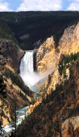 lower yellowstone falls: Landscape image shows Lower Falls and the Yellowstone River in Yellowstone National Park.  Steep canyon walls are tinyellow and orange. Stock Photo
