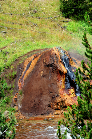 thermal spring: Heat and steam escapes from Chocolate Pot besides the Gibbon River in the Yellowstone National Park.