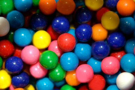 gumballs: Background of colorful gumballs sit in a pile.