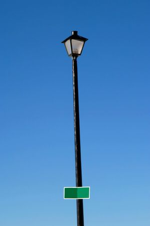 Extra tall street light zooms into the blue sky over Colorado Springs, Colorado.  Blank street sign can be personalized.  Suggestion might be city highlights, highlight your life, etc.