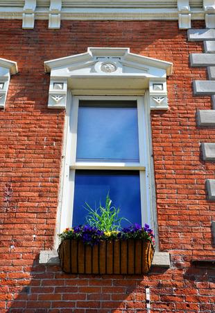enhances: Elegant architecture enhances this window and flower box, in Bozeman, Montana.