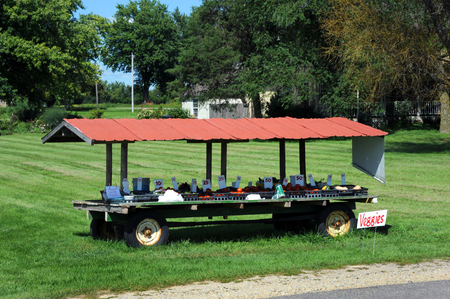roadside stand: Fresh vegetables are sold at this road-side stand in Wisconsin.  Tomatoes, squash and even goats milk; just help yourself and leave the money.