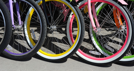 spokes: Background image shows a group of colorful bicycles.  Bikes are for rent in Bozeman, Montana. Stock Photo