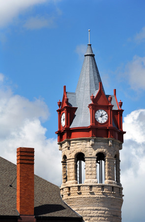victorian architecture: Soughton Clock Tower is framed by a blue sky and clouds.  Historic Victorian architecture stands near downtown.