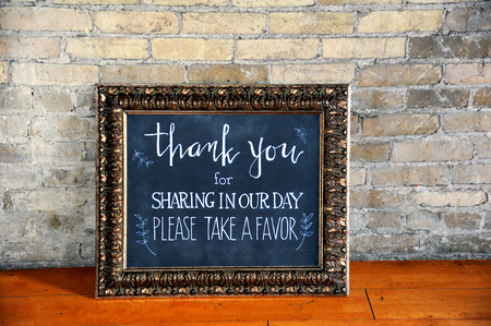 framed picture: Chalk board framed in an elegant, vintage picture frame, gives message to wedding guests thanking them for attending and giving them a favor.