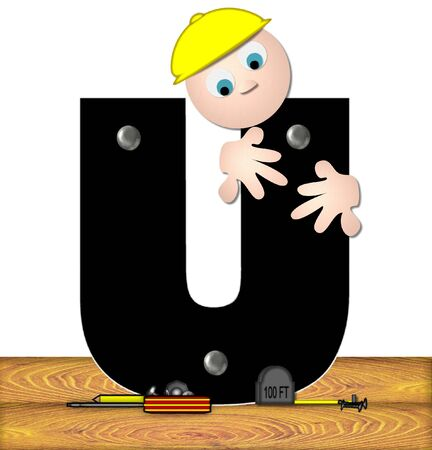 inspecting: The letter U, in the alphabet set Construction Worker, is black with silver nails embedded in letter.  Construction worker bends over inspecting letter.  Tools sit beside letter on wooden planks. Stock Photo