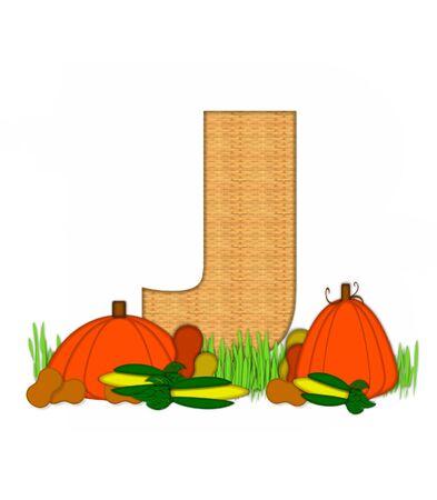"""bounty: La letra J, en el conjunto del alfabeto de """"Beato Bounty"""", está lleno de textura de mimbre. Carta sienta en el campo de hierba rodeado de verduras de otoño."""