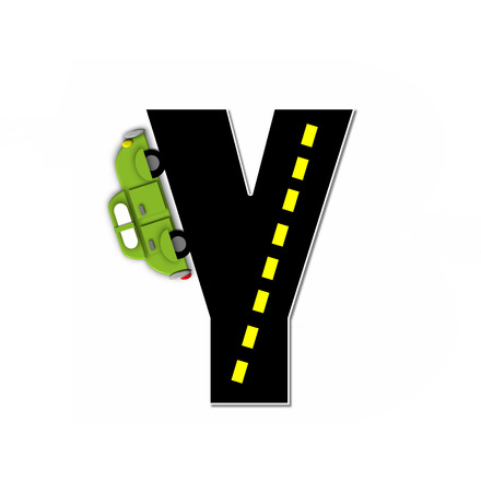 motorized: The letter Y, in the alphabet set Transportation by Road, is black with yellow dividing line representing a black top road.  Colorful, motorized vehicle navigates outside of letter. Stock Photo