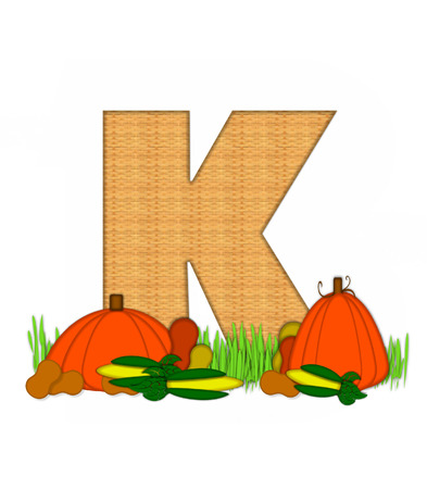 The letter K, in the alphabet set Blessed Bounty, is filled with wicker texture.  Letter sits in grassy field surrounded by Fall vegetables. Stock Photo