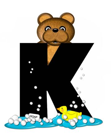 bathtime: The letter K, in the alphabet set Teddy Bath Time, is black and sits on a pool of spilled bath water.  Brown teddy bear, bubbles and yellow duck decorate letter. Stock Photo