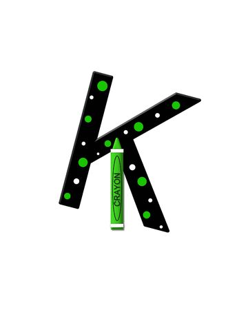 further: The letter K, in the alphabet set Black to School, is black with polka dots.  A crayon is added for further decoration. Stock Photo