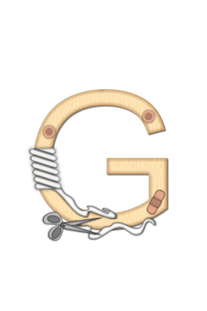 doctoring: Alphabet letter G, in the set Boo Boo, is tan to represent the color of skin.  Each letter is bandaged and has bandage applied. Stock Photo