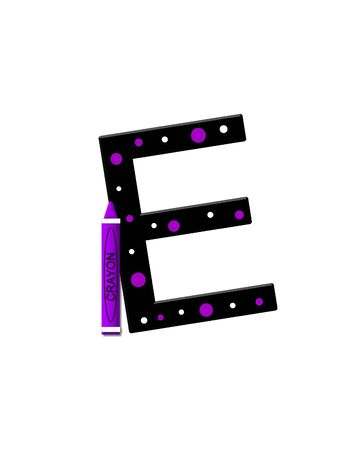 further: The letter E, in the alphabet set Black to School, is black with polka dots.  A crayon is added for further decoration. Stock Photo