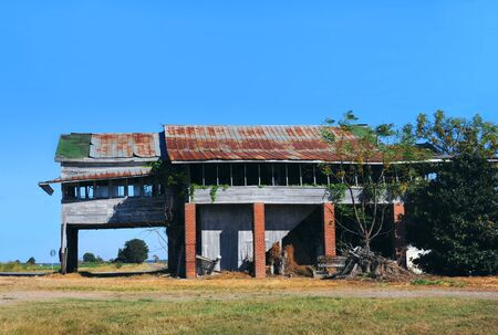 damaged roof: Abandoned and derelict country store sits at the corner of a highway in Northern Louisiana.