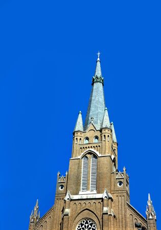 st  joseph: St. Josephs Catholic Church in Greenville, Mississippi, stands tall against a clear blue sky.