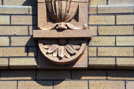 enhances: Decorative Stonework enhances the exterior of the old train depot in Livingston, Montana. Stock Photo