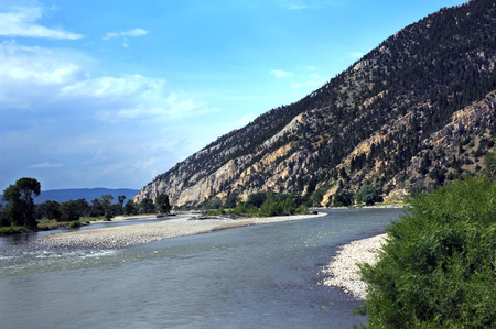 Yellowstone River curves around mountain at Carters Bridge Access Site.  Image shows beach, shoal and curving river. Stock Photo