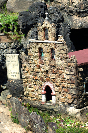 Old Spanish Mission recreated out of stone and concrete is displayed at the Ave Maria Grotto in Cullman, Alabama.