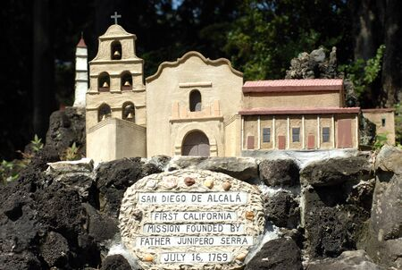 Reproduction of San Diego De Alcala at the Ave Maria Grotto in Cullman, Alabama, shows exterior of mission. Редакционное