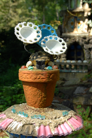 This unusual flower pot and flowers is part of the Ave Maria Grotto in Cullman, Alabama.