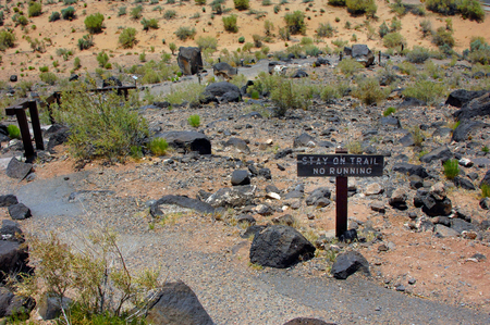 Curving trail leads from the Petroglyph National Monument Headquarters up the hill to the basalt petroglyphs.