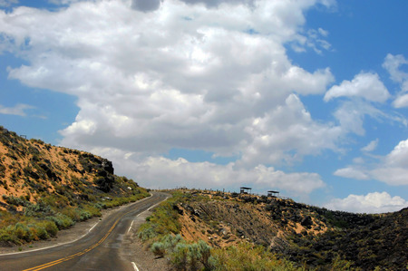 Road curves around the Boca Negra Upper Canyon of the Petroglyph National Monument in Albuquerque, New Mexico. Stock Photo