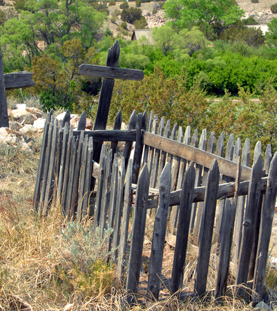 Rustic wooden fence surrounded a very old grave at the El Rancho del las Golondrinas ranch, a living history museum outside of Santa Fe, New Mexico.